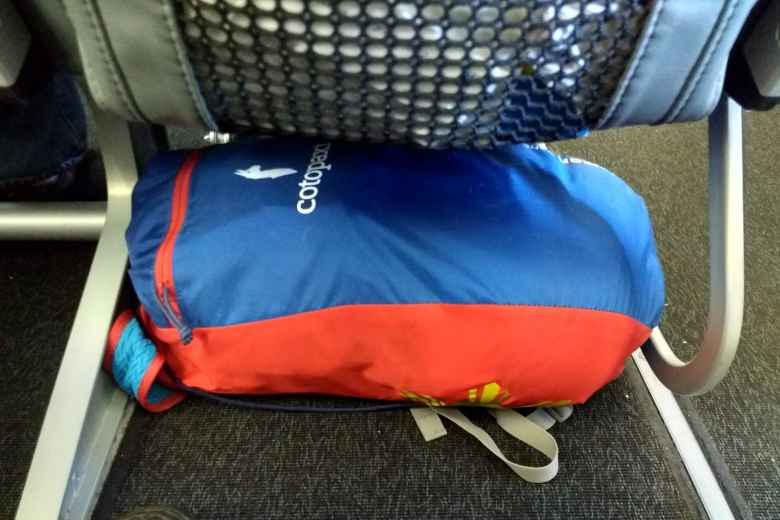 My Cotopaxi Luzon 18L pack---which carried all my gear for six weeks in Spain, including hiking the Camino de Santiago---was small enough to count as a no-charge personal item and fit underneath an airplane seat on Frontier Airlines.