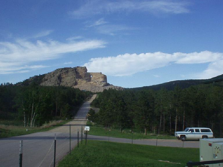The Crazy Horse Monument, started by sculptor Korczak Ziolkowski, remains a work in progress.  It is the largest rock sculpture in the world, dwarfing nearby Mt. Rushmore.