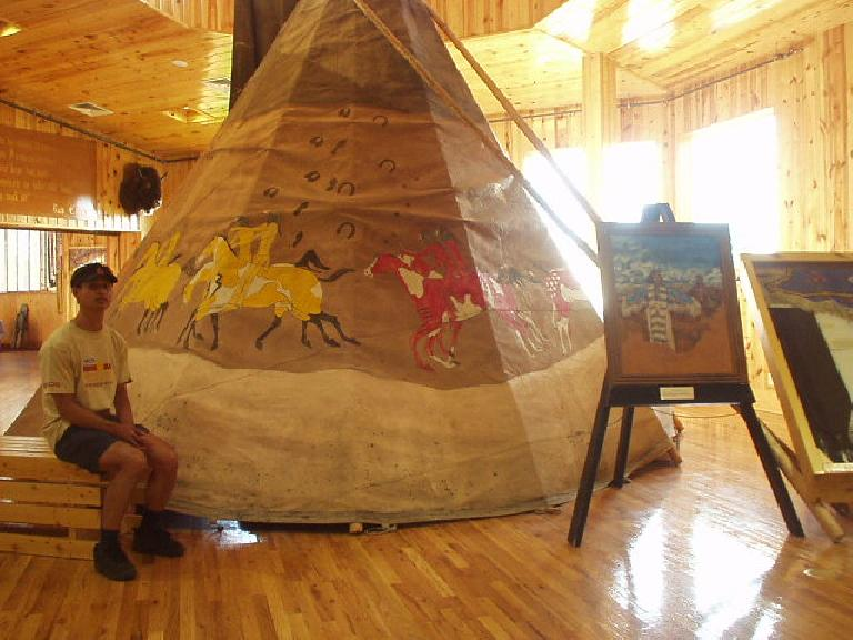 Felix Wong sits by a teepee inside the Indian Museum of North America.