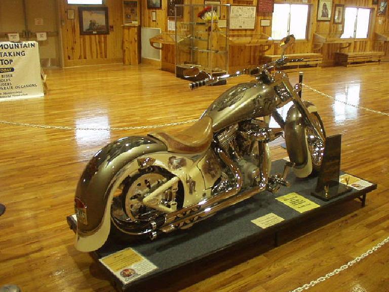 A custom Crazy Horse cruiser bike inside the Orientation Center.
