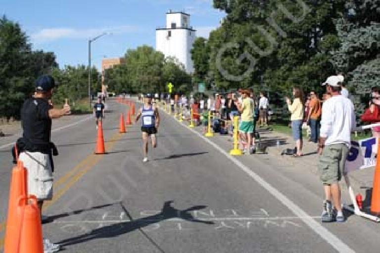 Sprinting down the final stretch in a desperate attempt to finish in sub-1:30. Photo: RunningGuru.com.