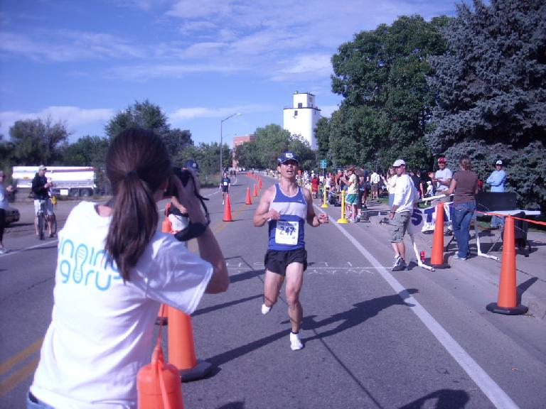 I only started slowing after crossing the finish line, but instead of finishing in sub-1:30 I finished in 1:30:00. Photo: Tanya Gallob.