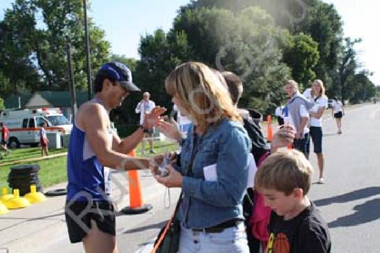 High-fiving the kids with Tanya looking on. Photo: RunningGuru.com.
