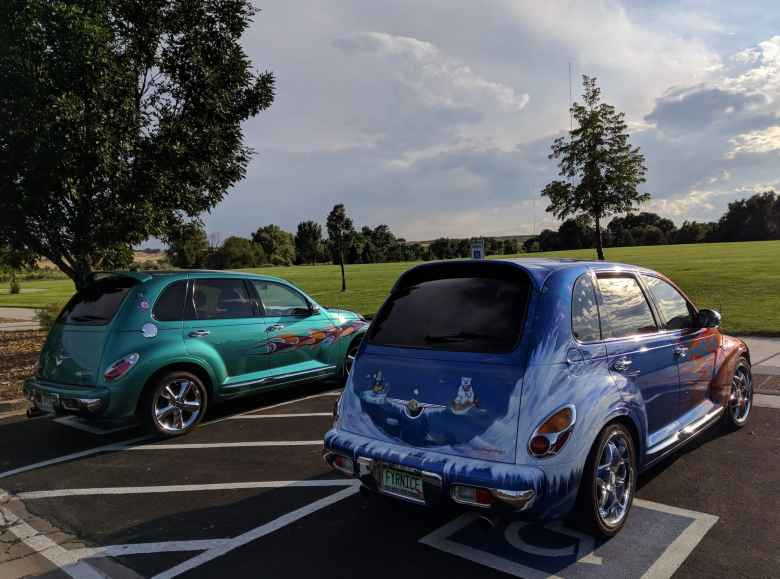 Two PT Cruisers with flames. The blue one had some sort of polar bear theme on it.