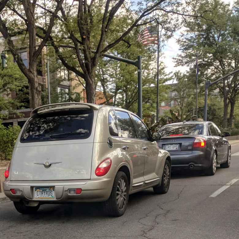 """A few days after the Cruise the Rockies event at Eastman Park, I encountered this PT Cruiser in Fort Collins that liked """"CTRYRDS."""""""