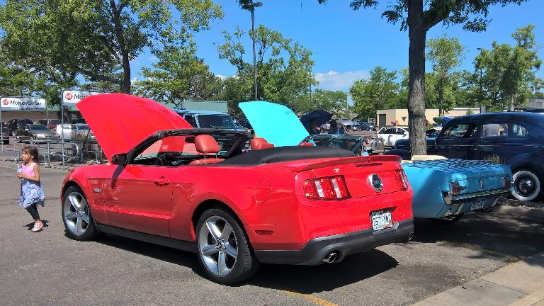 A red 2011 Ford Mustang convertible with a 1966 Columbine blue High Country Special Ford Mustang convertible.