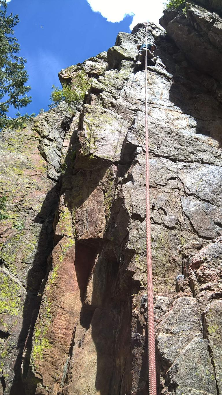 Felix Wong climbing County Line (5.8) in the Southwest Alcove of Crystal Wall.