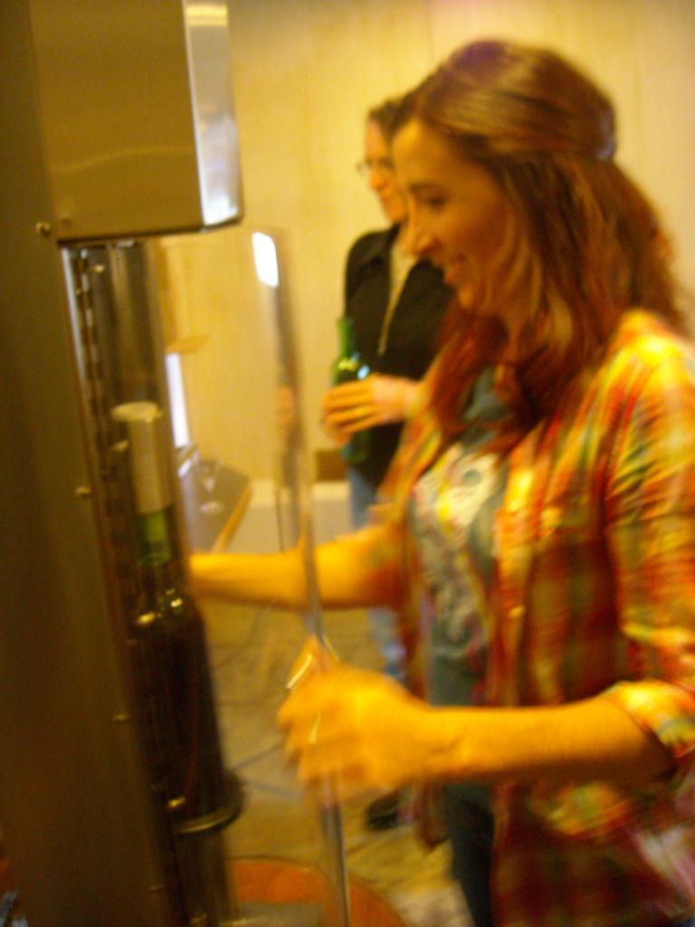 Tori corking the wine