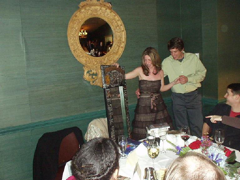 Susan talks about her present to Dan, a wonderful custom-made mirror featuring different facets of Dan's life/personality.