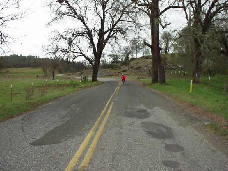 """Mile 102, 2:30 p.m.: Following the recumbent down Big Canyon, storm clouds were now evident all around.  """"Looks like we're in for an epic,"""" said the recumbent rider."""