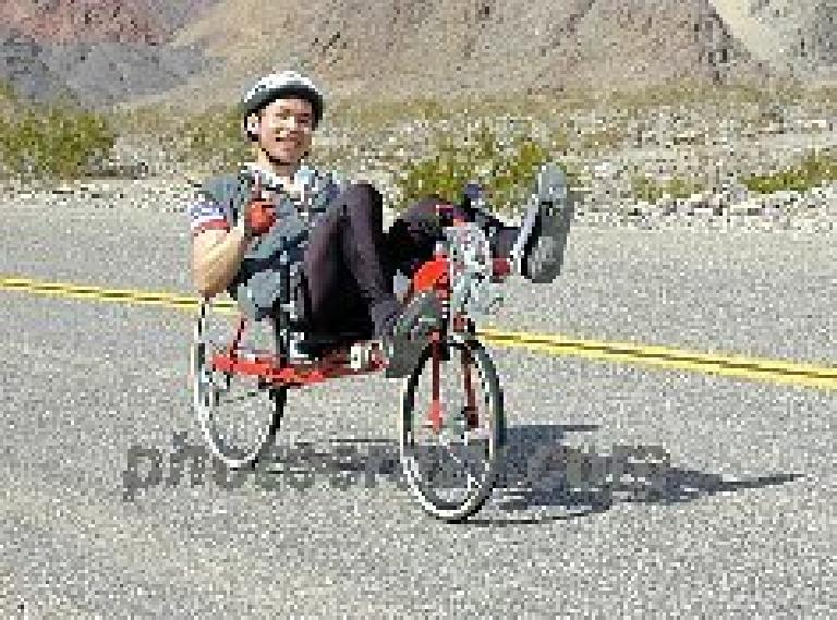 Felix Wong riding a red Reynolds Wishbone recumbent, 2000 Death Valley Double Century