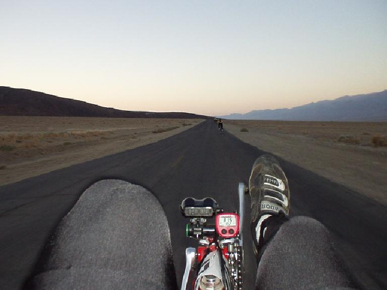 Mile 5, 6:13 a.m.: The view from my recumbent in the early going in the desert.  Note the speed (31.5 mph) I am going on almost-flat land.  I'd quickly catch the cyclists ahead, at least momentarily!