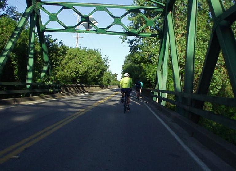 [Mile 10, 7:40 a.m.] Riders ahead on a bridge.