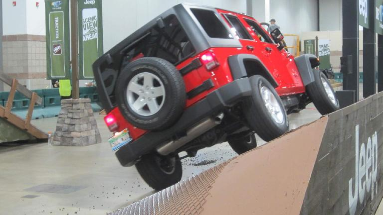 red 2015 Jeep Wrangler, sideways incline, 2015 Denver Auto Show