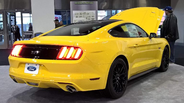 Yellow 2016 Ford Mustang coupe.