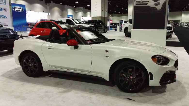 A white Fiat 124 Spider Abarth.
