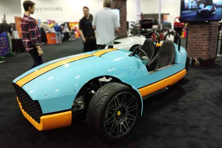 A Vanderhall Venice in blue and orange racing colors akin to Gulf Oil's.