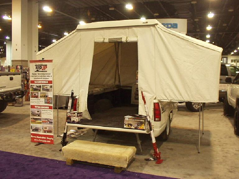 Here's an aftermarket pop-out camper shell.  You could practically live in this thing.