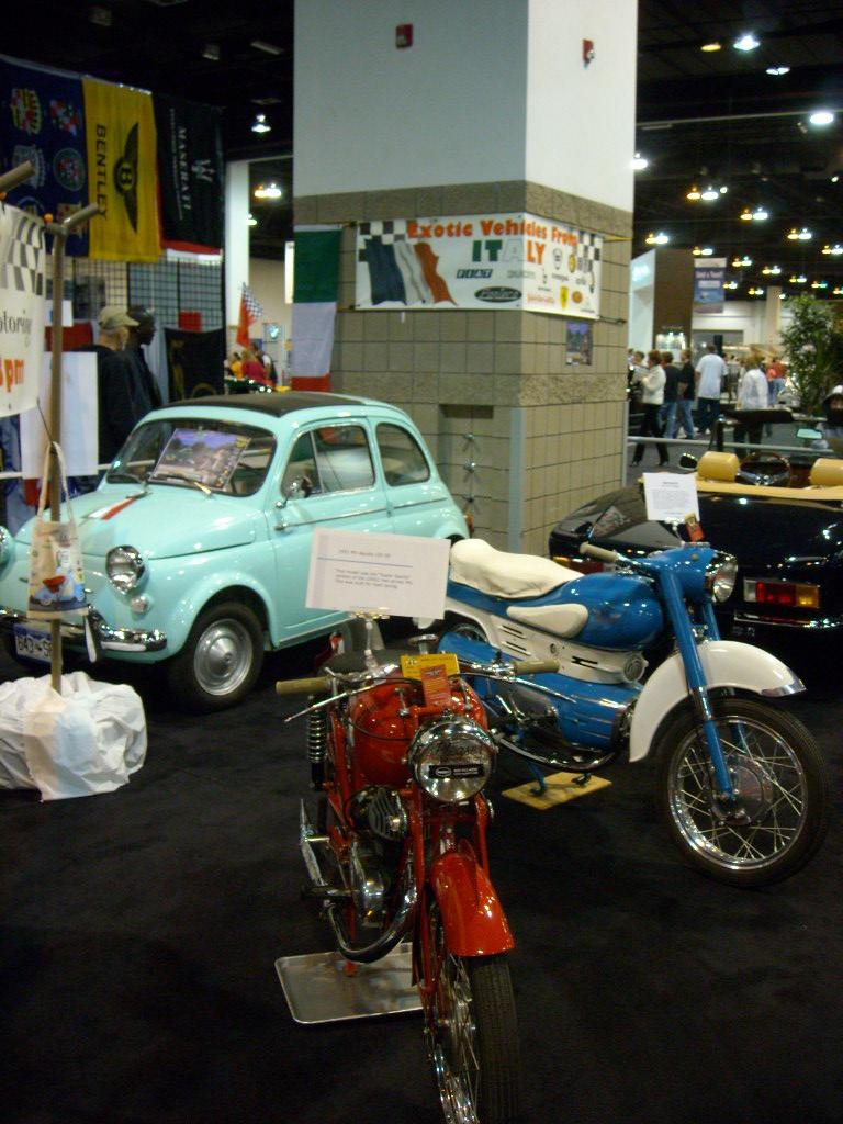 A couple classic motorcycles (including an MV Agusta) and Fiat 500.