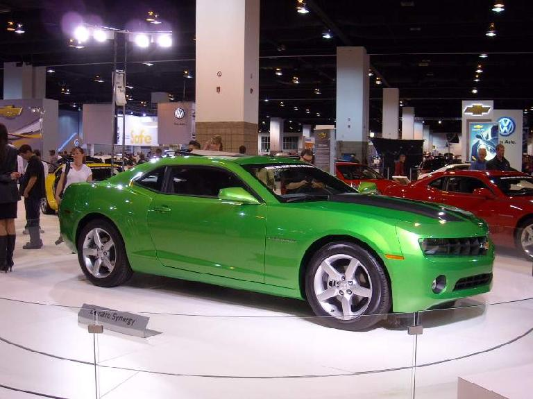 Compared to the Stingray concept, the Camaro looks quite bland even in this odd shade of green.