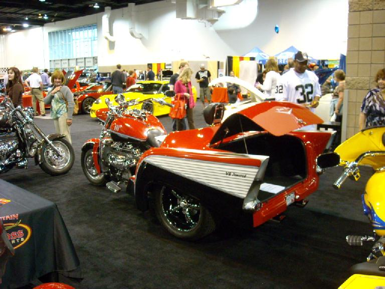 Half motorcycle, half 50s Cadillac (Chevy?)