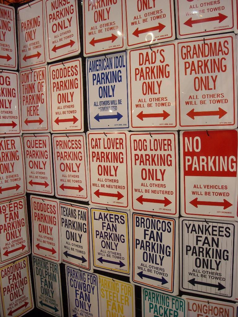 """Parking signs.  The """"cat lover"""" one could have applied to me."""