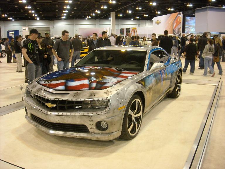 A Chevrolet Camaro painted with a patriotic motif.