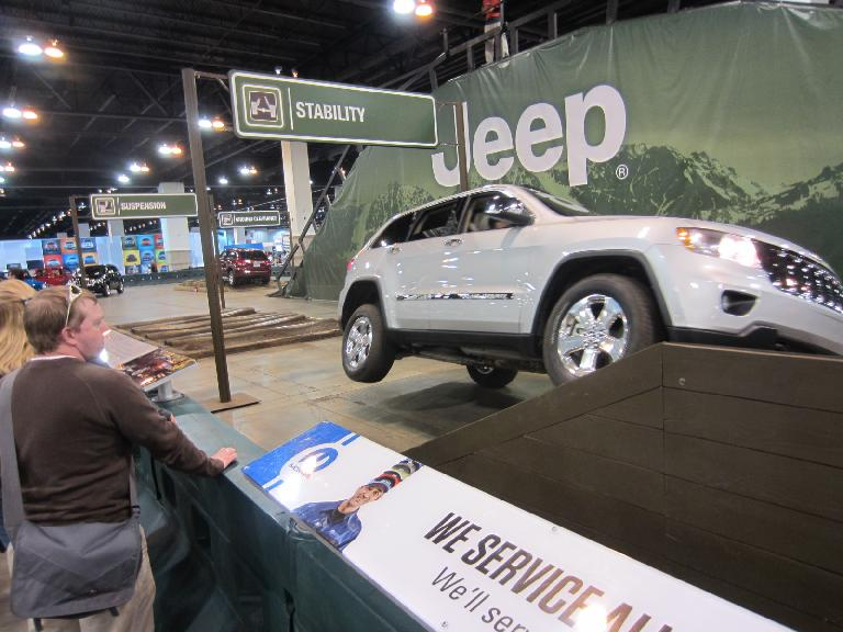 A Jeep Grand Cherokee going over a 30-degree ramp.