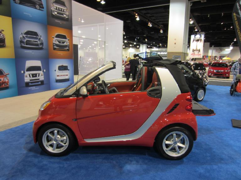 A Smart car is barely longer than a motorcycle!