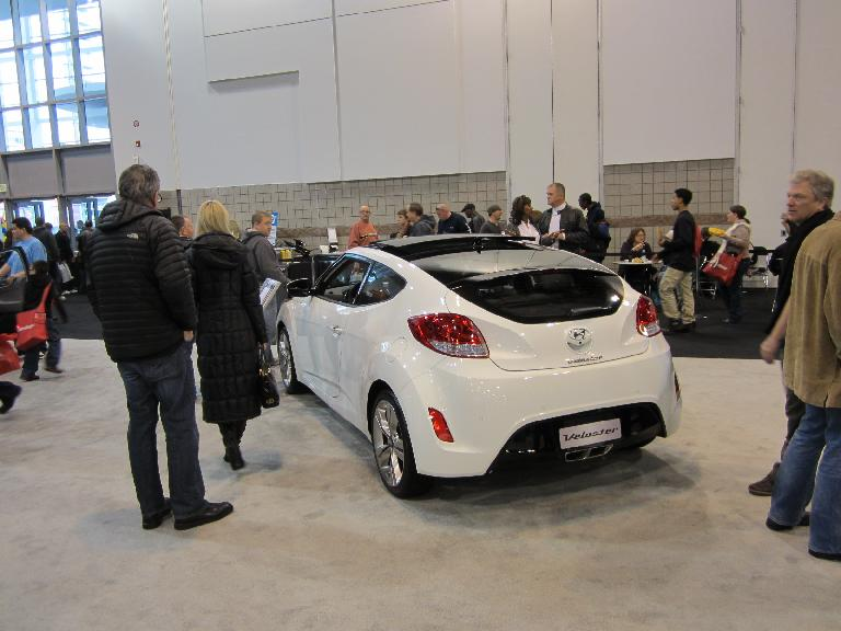 Personally I preferred the Veloster over the CR-Z, which is more stylish, has a rear seat, fourth door (on the right), and with the optional turbo, faster.