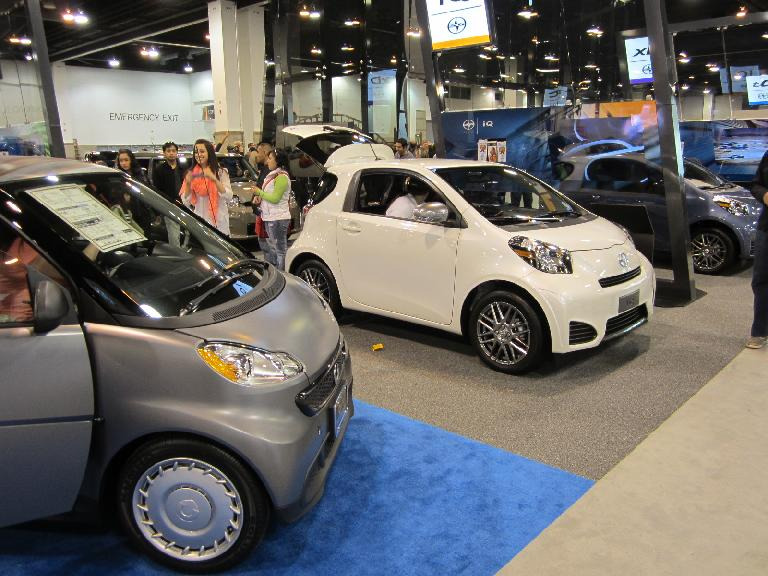 """A Smart """"pure coupe"""" (left) and two Scion IQs (center and right)."""