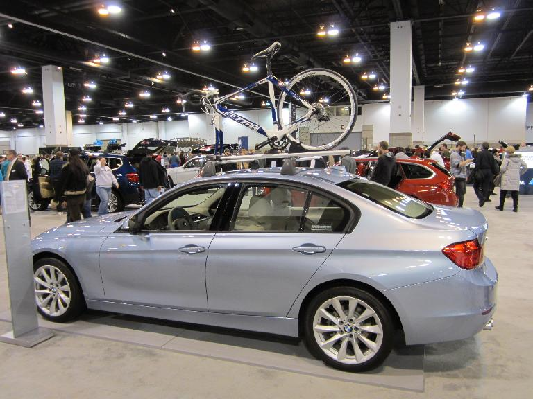 A BMW 3-series with a Fezzari (a Florida outfit clearly trying to ride the Ferrari mystique) road bike.
