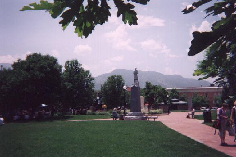 [Boulder] A fountain at the Pearl Street Mall, with the iconic Flatirons in the background. (May 31, 2003)