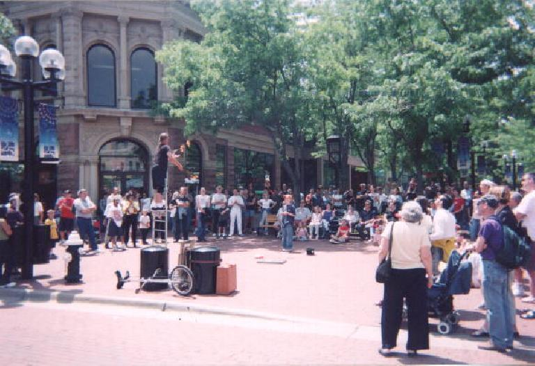 [Boulder] At the Pearl Street Mall, a dude was juggling sticks of flames while balancing on a ladder! (May 31, 2003)