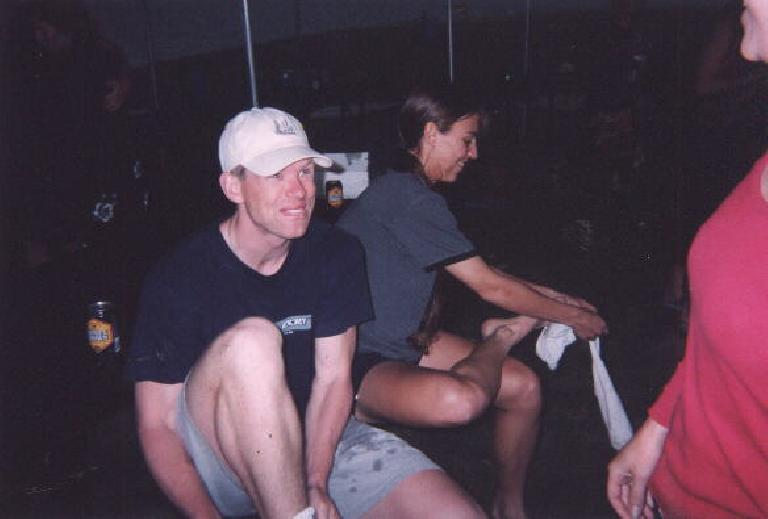 [Boulder] Shane and Anne putting on socks after a thunderstorm crept in while playing volleyball at the Res. (May 31, 2003)