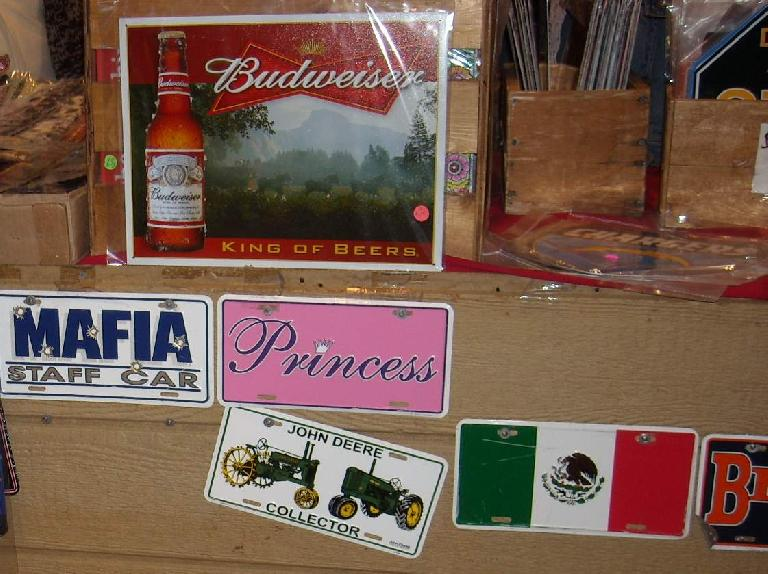 Mafia, Princess, and Jon Deere license plates.