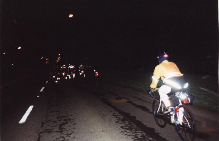 Mass start of >100 riders at 5:00 a.m.  Up ahead is the lead pack.