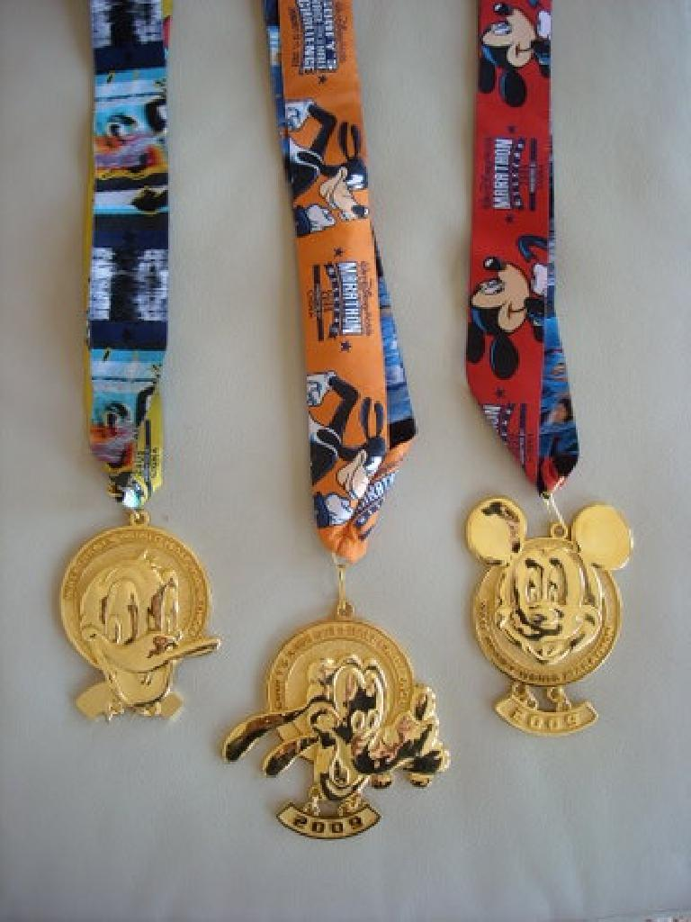 Medals from the Disney World Half Marathon, Goofy's Race-and-a-Half Challenge, and full marathon.