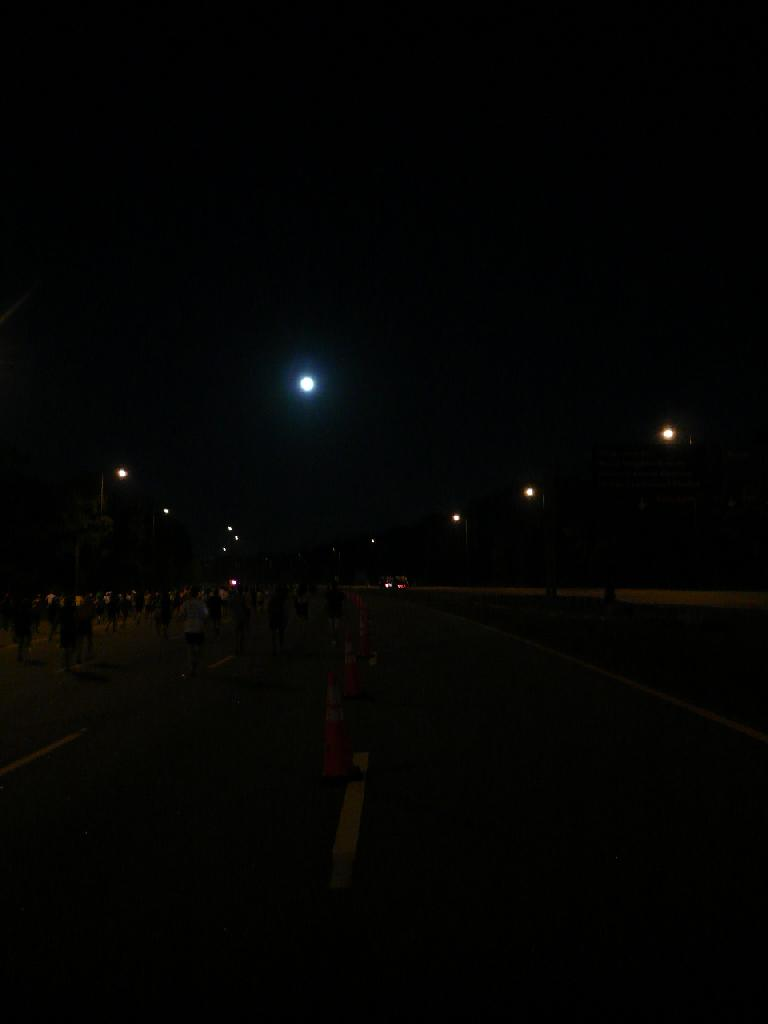 [Mile 4, 6:32 a.m.] A full moon lit up Epcot Center Dr.