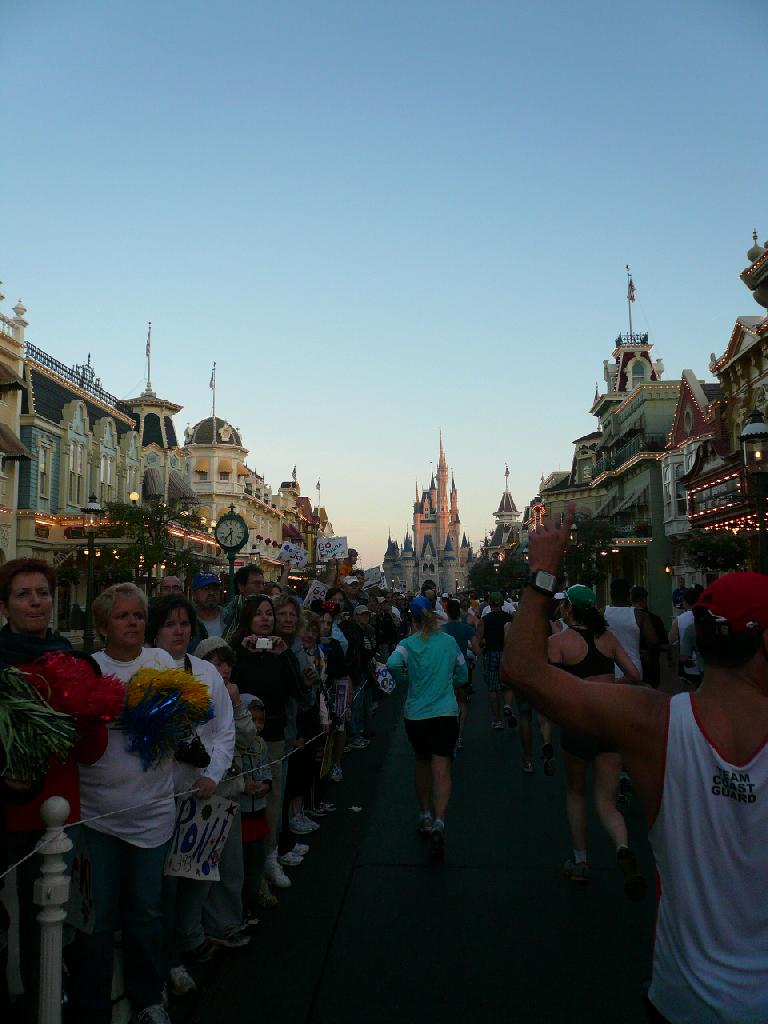 [Mile 10, 7:26 a.m.] Being cheered on by dense crowds before the Magic Kingdom.