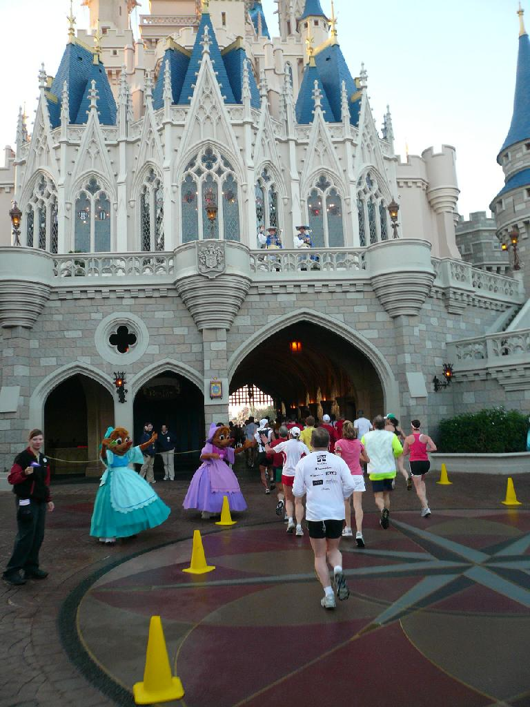 [Mile 10.5, 7:31 a.m.] Running through the Magic Kingdom.