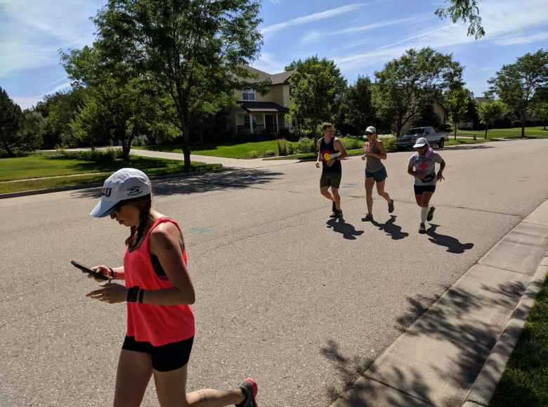 Brooke, Casey, Rachel, and Alene running through the Hearthfire neighborhood.