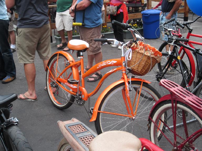 Orange cruiser with basket.