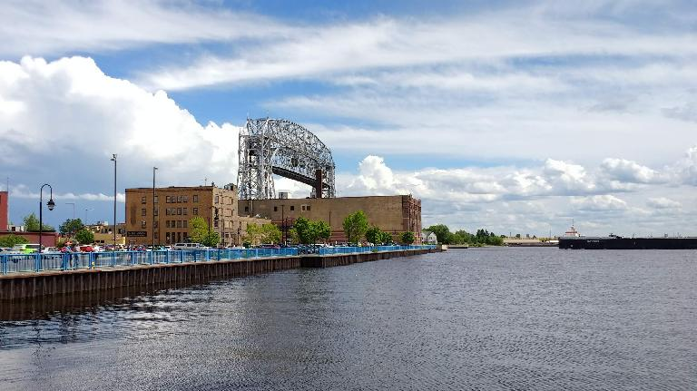 A long ship about to pass under the Aerial Lift Bridge in Duluth, Minnesota.