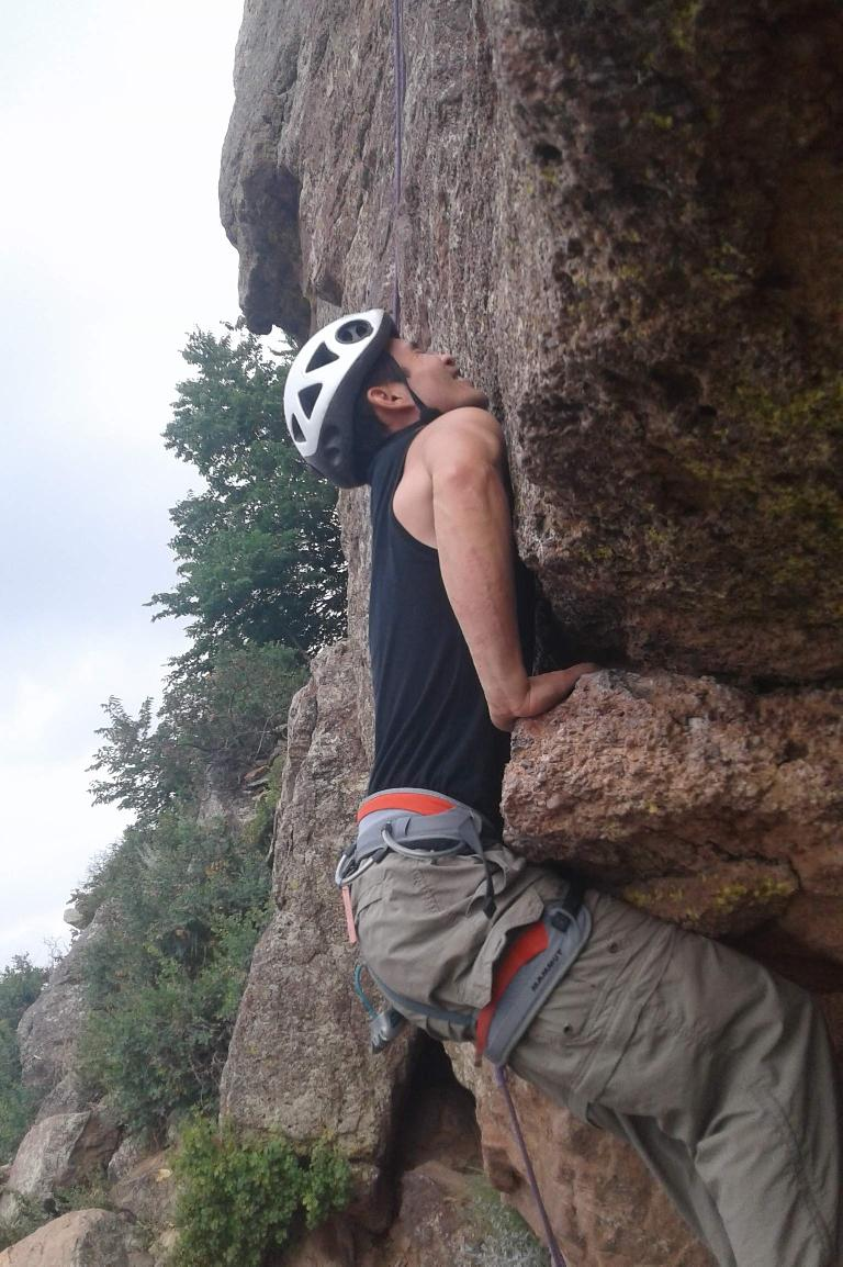 Felix Wong attempting to mantle the start of Roof Route at Duncan's Ridge.