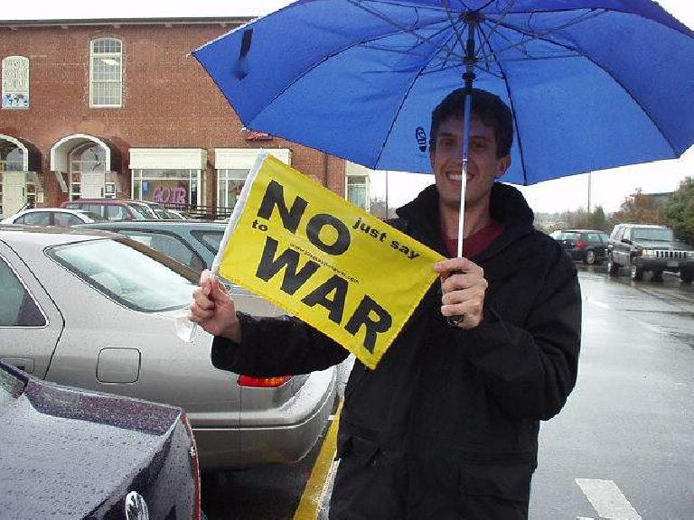 yellow No War sign, Dan, blue umbrella