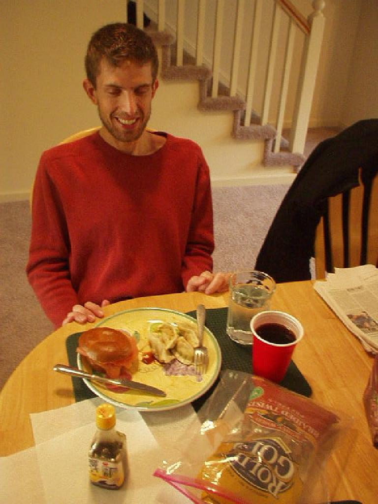 Dan and the great nova-lox-on-bagel and pot stickers he made for us.  Thanks for the fun times, Dan! (January 1, 2006)