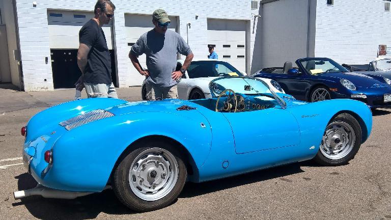 A cyan 1955 Porsche Spyder replica.