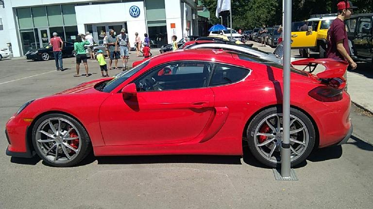A red 2016 Porsche GT4 based off the Porsche Cayman.