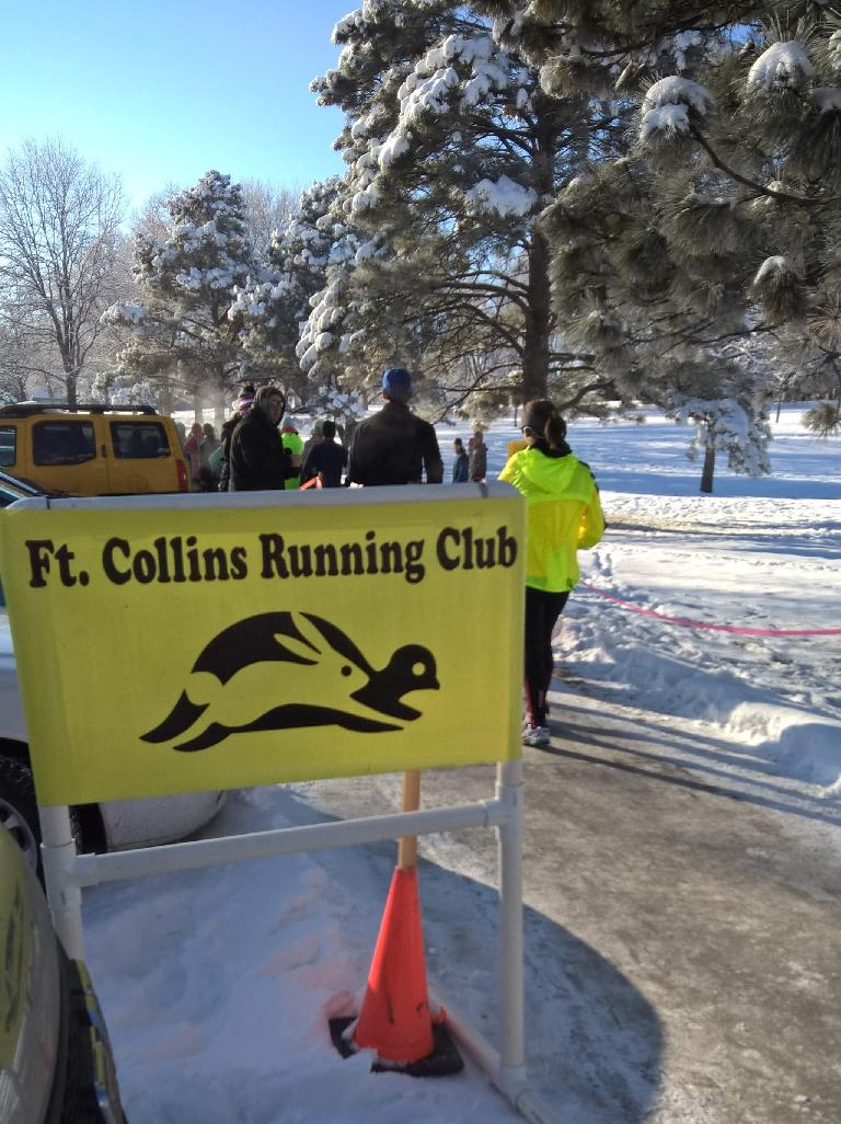 Fort Collins Running Club yellow sign, finishing chute, Edora Park 8k